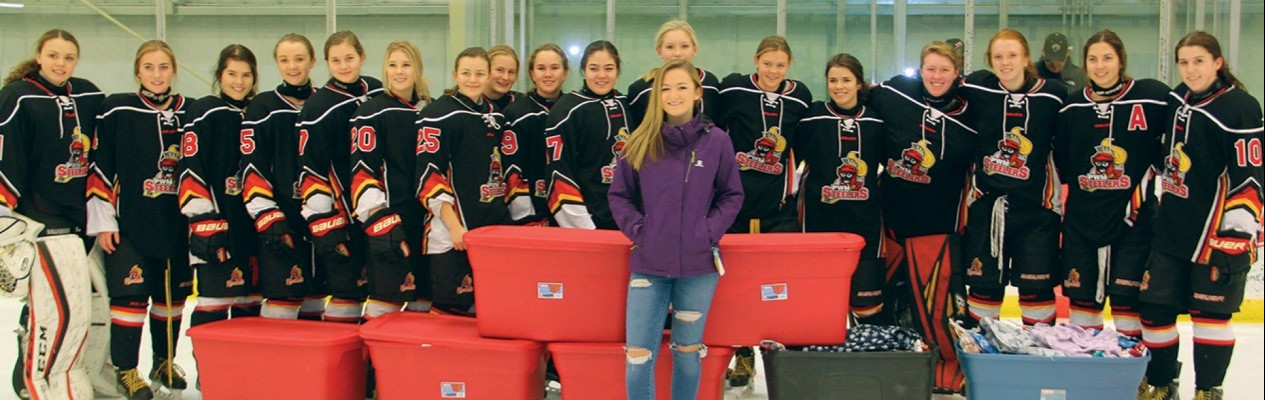 The Lloydminster PWM Steelers present 513 pairs of pajamas to Olivia Brockhoff for Project PJ